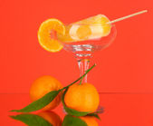 Yellow fruit juice ice in vase on red background — Stock Photo