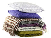 Warm plaids and colorful pillows isolated on white — Stock Photo