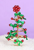 Wire Christmas tree on lilac background — Stock Photo