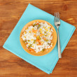 Risotto on color plate on wooden background — Stock Photo #18402709