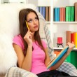 Portrait of female reading book at home — Stock Photo #18402795