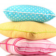 Blue, pink and yellow bright pillows isolated on white — Stock Photo