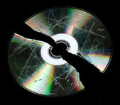 Defective and broken disk with information isolated on black — Stock Photo