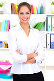 Young business woman at office — Stock Photo