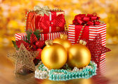 Christmas decoration and gift boxes on golden background — Stock Photo
