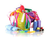 Color bucket with multicolor ribbons and thread isolated on white — Stock Photo