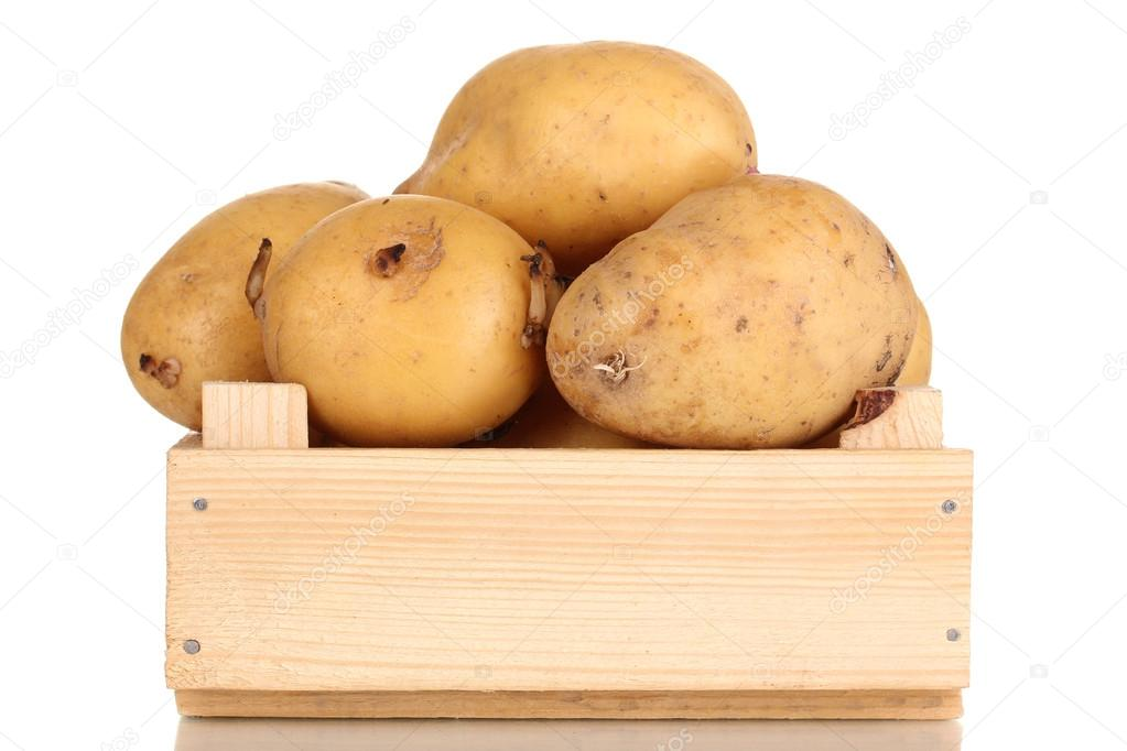 Ripe potatoes on wooden box isolated on white — Stock Photo #18402453