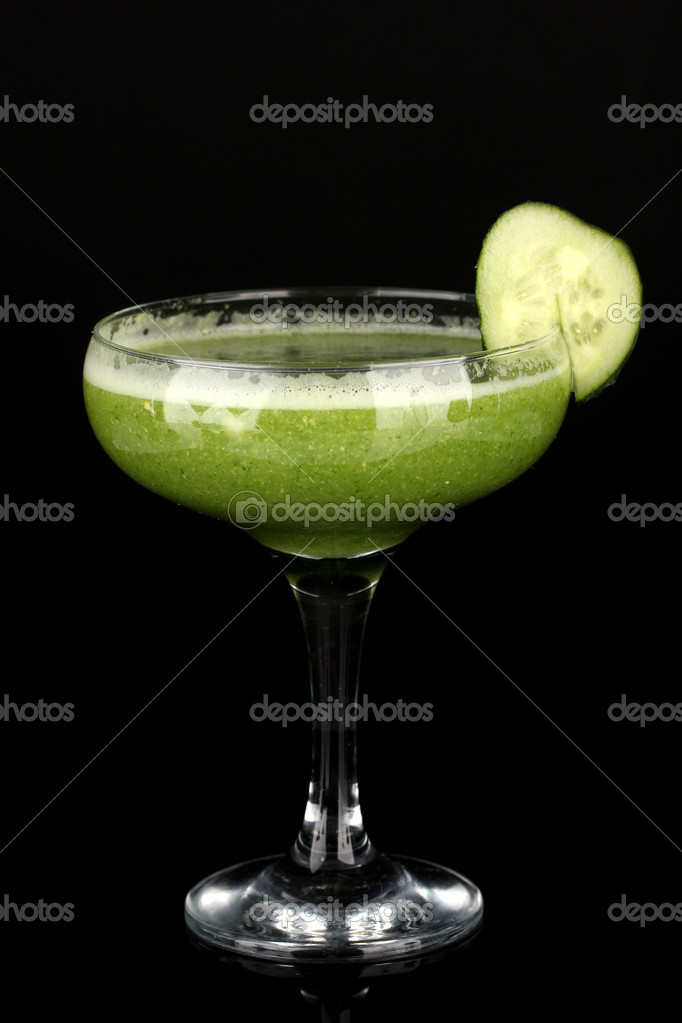 Green vegetable juice in coctail glass isolated on black — Stock Photo #18402533