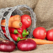Fresh red vegetables on sackcloth background - Стоковая фотография