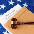 Divorce decree and envelope on american flag background - Stock Photo