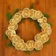 Christmas wreath of dried lemons with fir tree, on wooden background — ストック写真