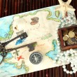 Stock Photo: Map of treasures on dark wooden background