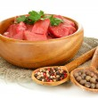 Raw beef meat in bowl with herbs and spices isolated on white - Stock fotografie