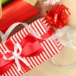Rolls of Christmas wrapping paper with ribbons, bows on wooden background - Stock fotografie