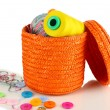 Orange wicker basket with accessories for needlework isolated on white - Stock fotografie