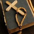 Bible, rosary and cross on wooden table close-up - Foto de Stock