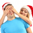 Stock Photo: Loving couple in Santa hats isolated on white