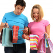 Young couple shopping and holding many shopping bags isolated on white — Foto Stock