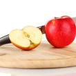Red apple and knife on cutting board, isolated on white — Stock Photo