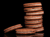 Chocolate cookies with creamy layer isolated on black — Stock Photo