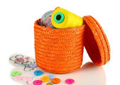 Orange wicker basket with accessories for needlework isolated on white — Foto Stock