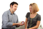 Young man making offer of marriage and giving ring to woman isolated on white — Stock Photo