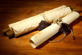 Old scrolls, on wooden background — Stock Photo