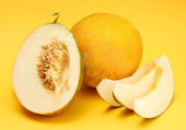 Ripe sweet melons, on yellow background — Stock Photo