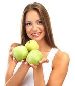 красивая молодая женщина с зелеными яблоками, изолированные на белом — Стоковое фото