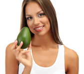 Beautiful young woman with avocado, isolated on white — Stock Photo