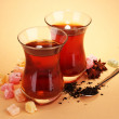 Glasses of Turkish tea and rahat Delight, on beige background — Stock Photo