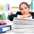 Sad business woman with documents in her workplace — Stock Photo