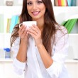 Young businesswoman drinking coffee — Stock Photo