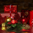 Christmas decoration and gift boxes on dark background - Stock Photo