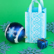 Christmas paper bag for gifts on green background - Zdjcie stockowe