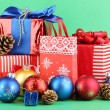New Year composition of New Year's decor and gifts on green background — Stockfoto