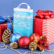 New Year composition of New Year's decor and gifts on blue background — Stock Photo