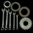 Stock Photo: Metal cogwheels and spanners isolated on black