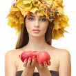 Beautiful young woman with yellow autumn wreath and apples, isolated on white — Stock Photo #18572561