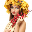 Beautiful young woman with yellow autumn wreath and red berries, isolated on white — Stock Photo