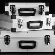 Stock Photo: Silvery suitcases on black background