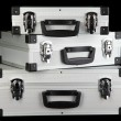 Silvery suitcases on black background — Stock Photo #18574117