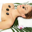 Portrait of beautiful woman with spa stones — Stock Photo