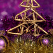 Christmas composition  with candles and decorations in purple and gold colors on bright background — Foto de Stock
