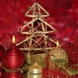 Christmas composition  with candles and decorations in red and gold colors on bright background - Stock Photo