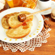 Stock Photo: White bread toast with honey and cup of coffee on wooden table