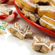 Christmas treats on plate isolated on white — Stock Photo