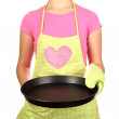 Closeup of homemaker in apron holding pisolated on white — Stock Photo #18576387