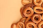 Tasty bagels, on beige background — Stock Photo
