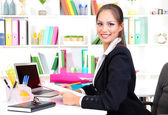 Young pretty business woman at workplace — Stock Photo